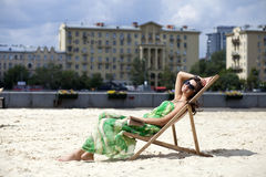 Beautiful woman relaxing lying on a sun lounger Royalty Free Stock Photo