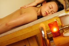 Beautiful woman relaxing in a massage salon. Royalty Free Stock Photo