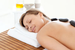 Beautiful woman relaxing on a massage table Stock Photo