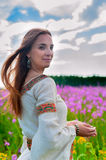 Beautiful woman relaxing on meadow with flowers Stock Photography