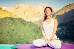 Beautiful woman relaxing and meditating outdoor at mountain Stock Photography