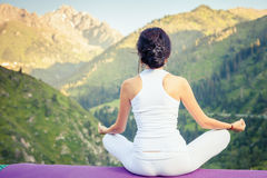 Beautiful woman relaxing and meditating outdoor at mountain Stock Image