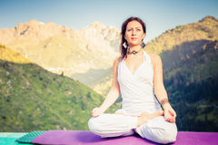 Beautiful woman relaxing and meditating outdoor at mountain Royalty Free Stock Photo