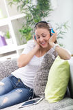 Beautiful woman relaxing with music. Woman wearing headphones and  relaxing with digital tablet Stock Image