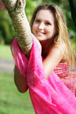 Beautiful woman relaxing on natural background Royalty Free Stock Photography