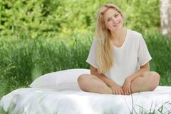 Beautiful woman relaxing on natural background Stock Image
