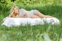 Beautiful woman relaxing on natural background Royalty Free Stock Images