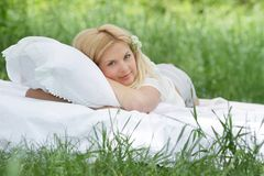 Beautiful woman relaxing on natural background Stock Images