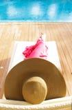 Beautiful woman relaxing near pool Stock Image