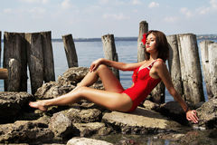 Beautiful woman relaxing near the water Royalty Free Stock Photography
