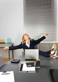 Beautiful woman relaxing in office Royalty Free Stock Images