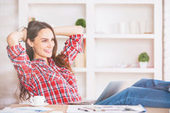Beautiful woman relaxing in office Royalty Free Stock Photo