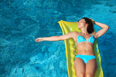 Free Beautiful Woman Relaxing On An Mattress In Poo Stock Photography - 13021332