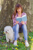 Beautiful Woman Relaxing Outdoor Reading Book Royalty Free Stock Photography