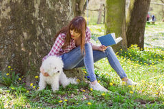 Beautiful Woman Relaxing Outdoor Reading Book Royalty Free Stock Image