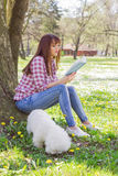 Beautiful Woman Relaxing Outdoor Reading Book Stock Photo