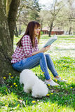 Beautiful Woman Relaxing Outdoor Reading Book Royalty Free Stock Photos