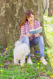 Beautiful Woman Relaxing Outdoor Reading Book Royalty Free Stock Photo