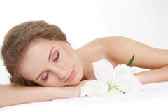 Beautiful woman relaxing over white Royalty Free Stock Photo
