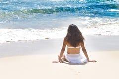 Beautiful Woman Relaxing in Paradise. Beautiful woman looking into the Ocean in Hawaii Royalty Free Stock Image