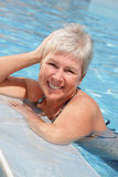 Beautiful woman relaxing by the pool Royalty Free Stock Photo