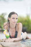 Beautiful woman relaxing in the pool Royalty Free Stock Photo