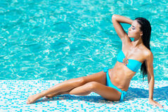 Beautiful woman relaxing in a pool Stock Photos