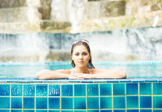 Beautiful woman relaxing in a pool at summer Royalty Free Stock Images