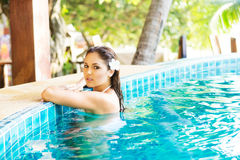 Beautiful woman relaxing in a pool at summer Stock Photos