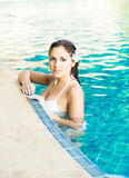 Beautiful woman relaxing in a pool at summer Stock Images