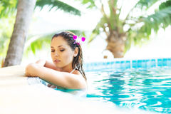 Beautiful woman relaxing in a pool at summer Royalty Free Stock Image