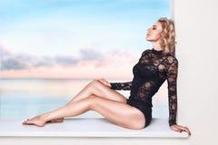 Beautiful woman relaxing in resort Stock Images