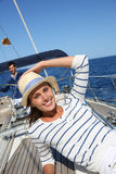 Beautiful woman relaxing on sailing boat Royalty Free Stock Photo