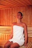 Beautiful woman relaxing a sauna Stock Images