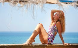 Beautiful woman relaxing on sea background Royalty Free Stock Photos
