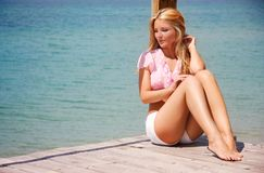 Beautiful woman relaxing on sea background Royalty Free Stock Photo