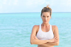 Beautiful woman relaxing by the sea after work out Royalty Free Stock Photo