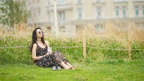 Cute woman relaxing in the park outdoors stock video footage