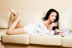 Beautiful woman relaxing on the sofa Stock Photography
