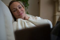 Beautiful woman relaxing on sofa royalty free stock image
