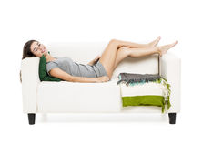 Beautiful woman relaxing on a sofa Royalty Free Stock Photos