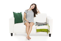 Beautiful woman relaxing on a sofa Stock Photos