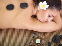Beautiful woman relaxing in spa center Stock Images