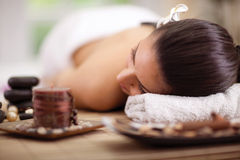 Beautiful woman relaxing in spa center Stock Photos