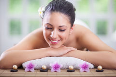 Beautiful woman relaxing in spa center Stock Image