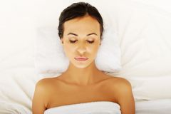 Beautiful woman relaxing in spa with closed eyes Stock Photography