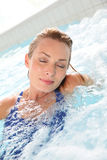 Beautiful woman relaxing in spa pool Stock Photography