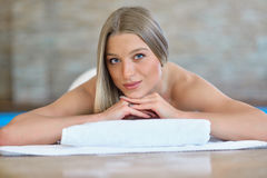 Beautiful woman relaxing in spa salon with hot stones on body. Beauty treatment therapy Stock Photos