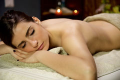 Beautiful woman relaxing in spa waiting for massage in vacation Stock Images