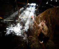 Beautiful woman relaxing in straw in autumn Royalty Free Stock Photography